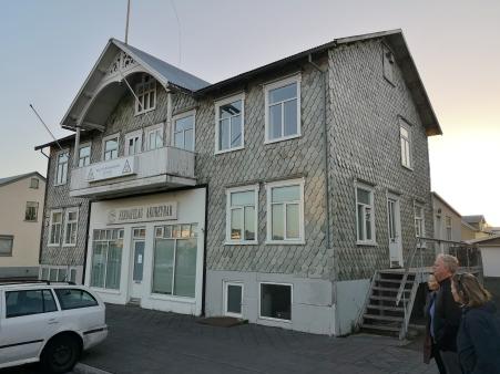 Slate tiled building along Akureyri Harbour