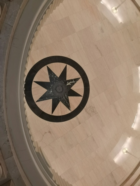 Star is in the center of the floor below but appears to follow you around the balcony