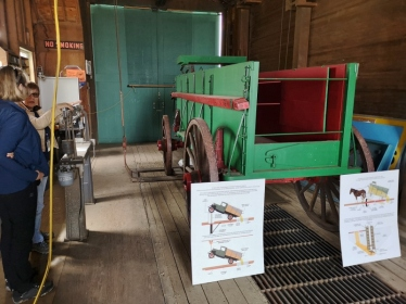 The wagon or truck was tilted upwards to pur the grain into the trough that led to the elevator