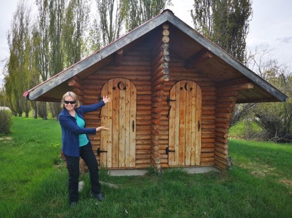 Sharon likes the cute Outhouse