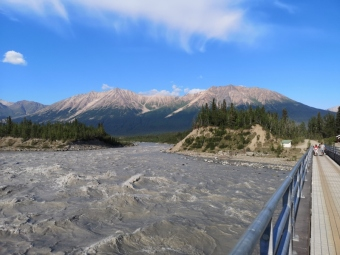 Crossing the footbridge to McCarthy over the Kennecott Glacial River