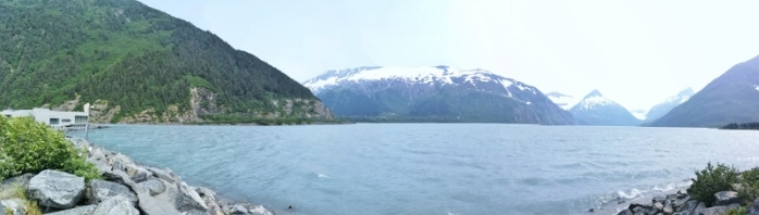 Visitor Centre on left and Portage Lake with Portage Glacier at far end