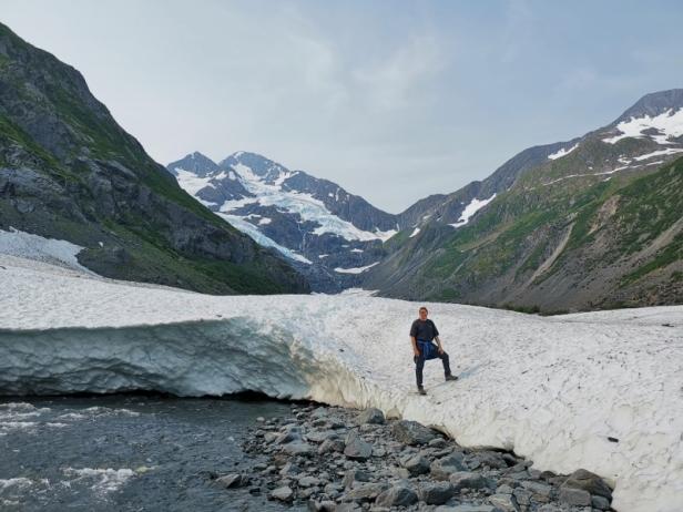 Joel on snow back below Byron Glacier