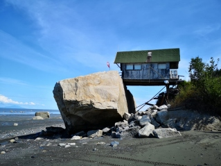 Barely suspended shack by the sea