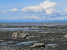 Snow covered volcanoes across Cook Inlet