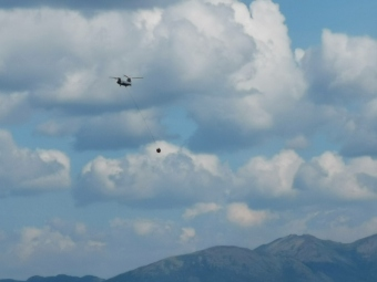 Helicopter still dropping water on forest fire hot spots