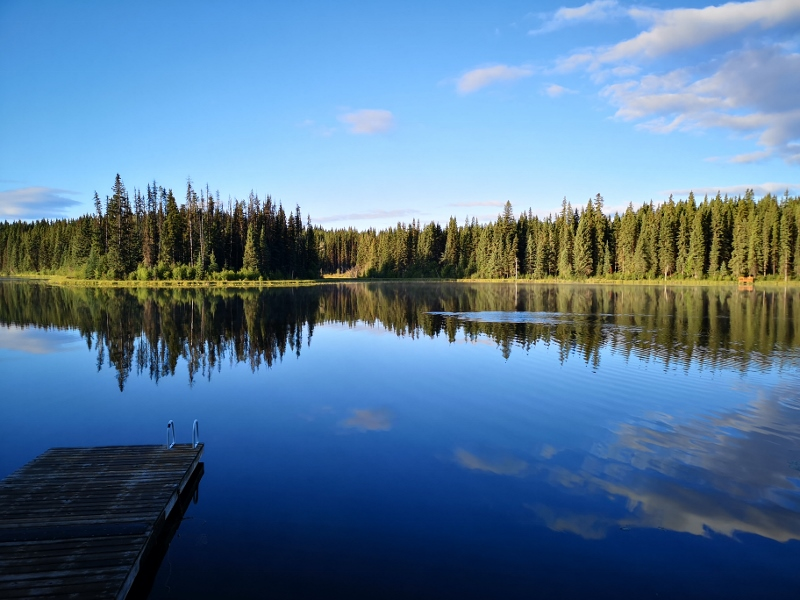 Kager Lake in the morning with a beaver swimming across