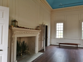 Long Room with original wood floors and trim
