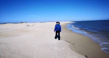 Sharon hunting for Sand Dollars on the busy 9 miles of St George Island Beach;-)
