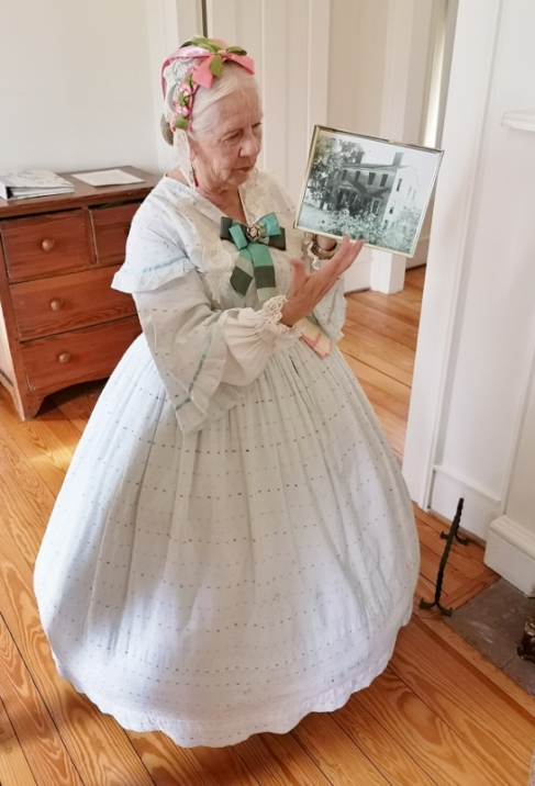 Our tour guide with an orginal photo when the house was first built in 1849