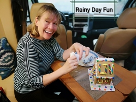Sharon having fun making her Gingerbread House with LTV logo