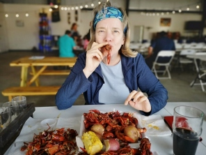 Sharon learns to suck the Crawfish heads for the tastey juices.