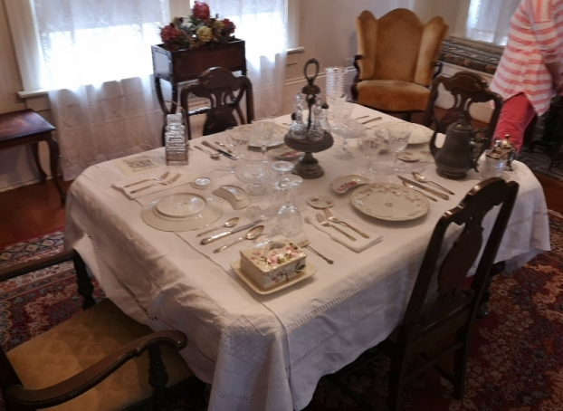 Dining room setup, bone dishes, each person had butter and salt. herring dish, pickle jar, sorry not in focus